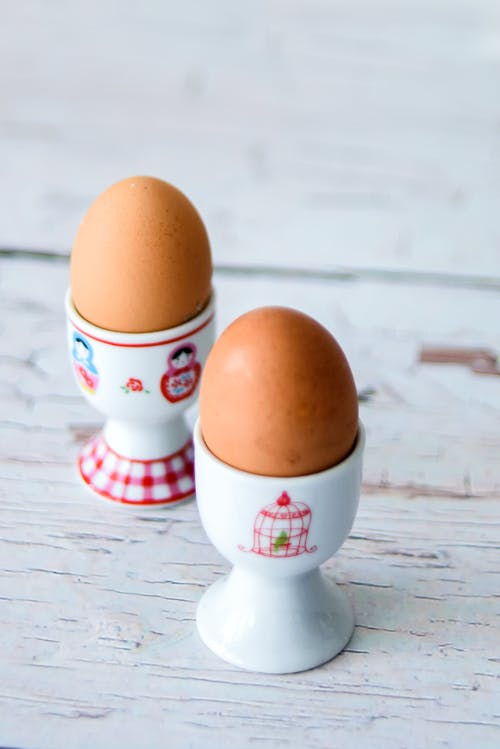 Brown Egg on White and Red Ceramic Cup