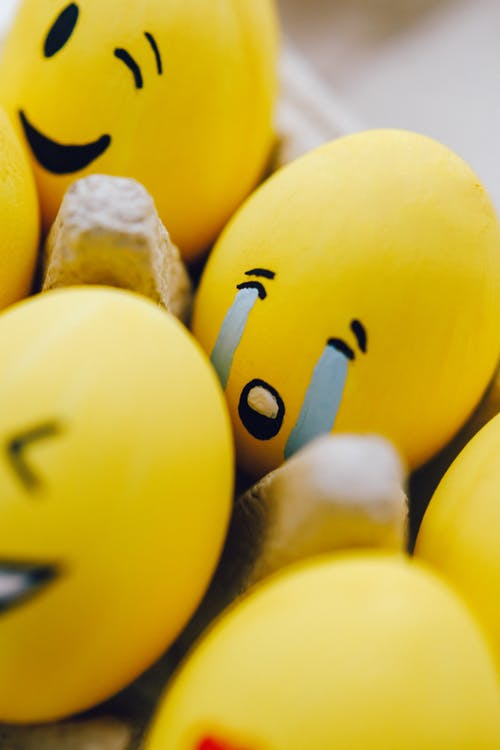 Yellow  Painted Sad Face Emoticon on Egg
