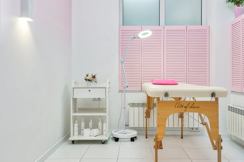Modern cosmetology office with couch under light lamp