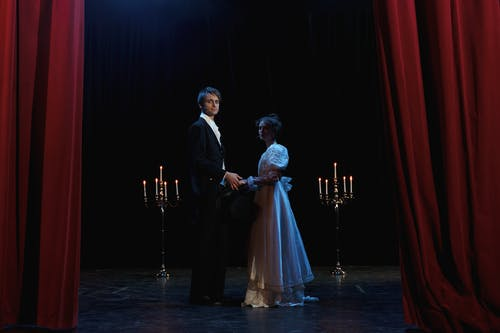 Man and Woman Standing on Stage