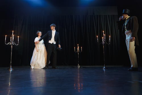 Two Men And Woman Acting On Stage