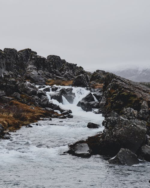 River flowing between rocky formations on hill