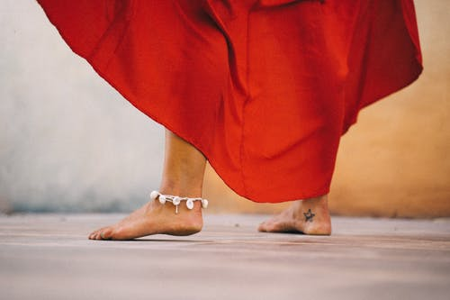 Photo Of a Bare Feet With Ankle  Accessory