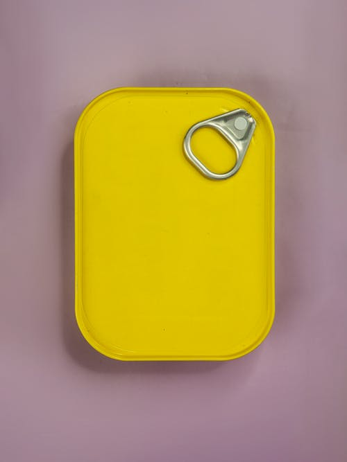 Yellow Plastic Container on White Table