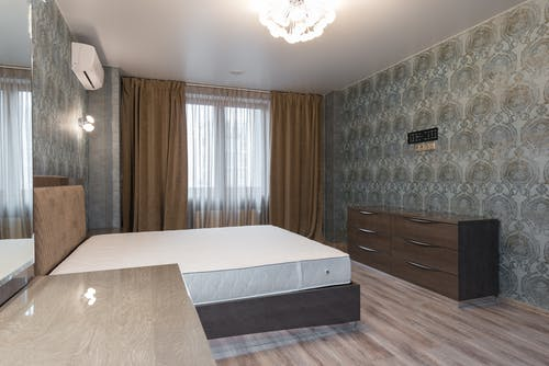Comfortable bedroom in minimalist style in flat