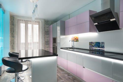Modern kitchen with pink cupboards