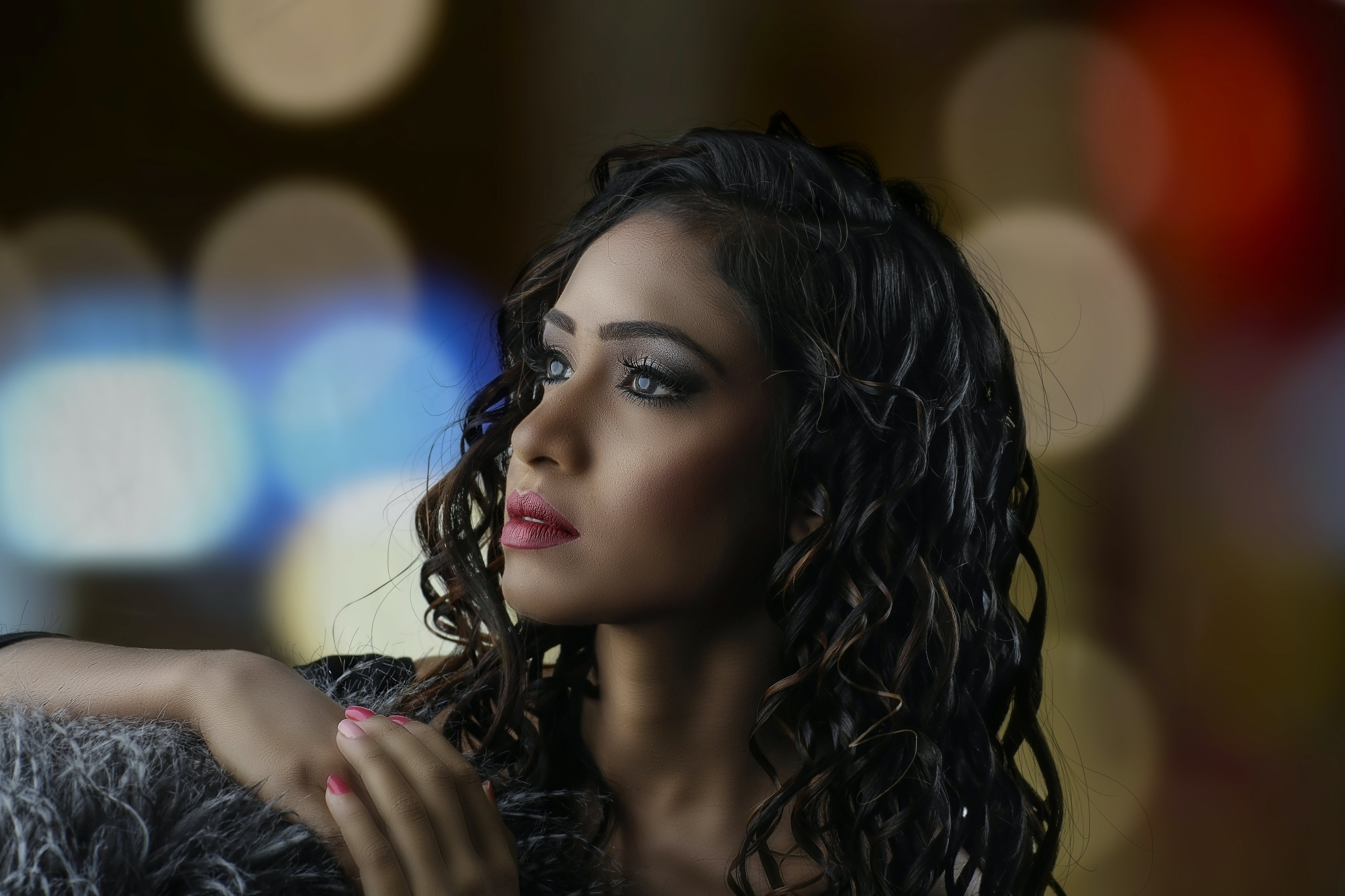 Bokeh Photography and Portrait of Curly-haired Woman