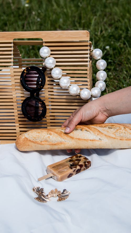 Person Holding Bread With White Pearl