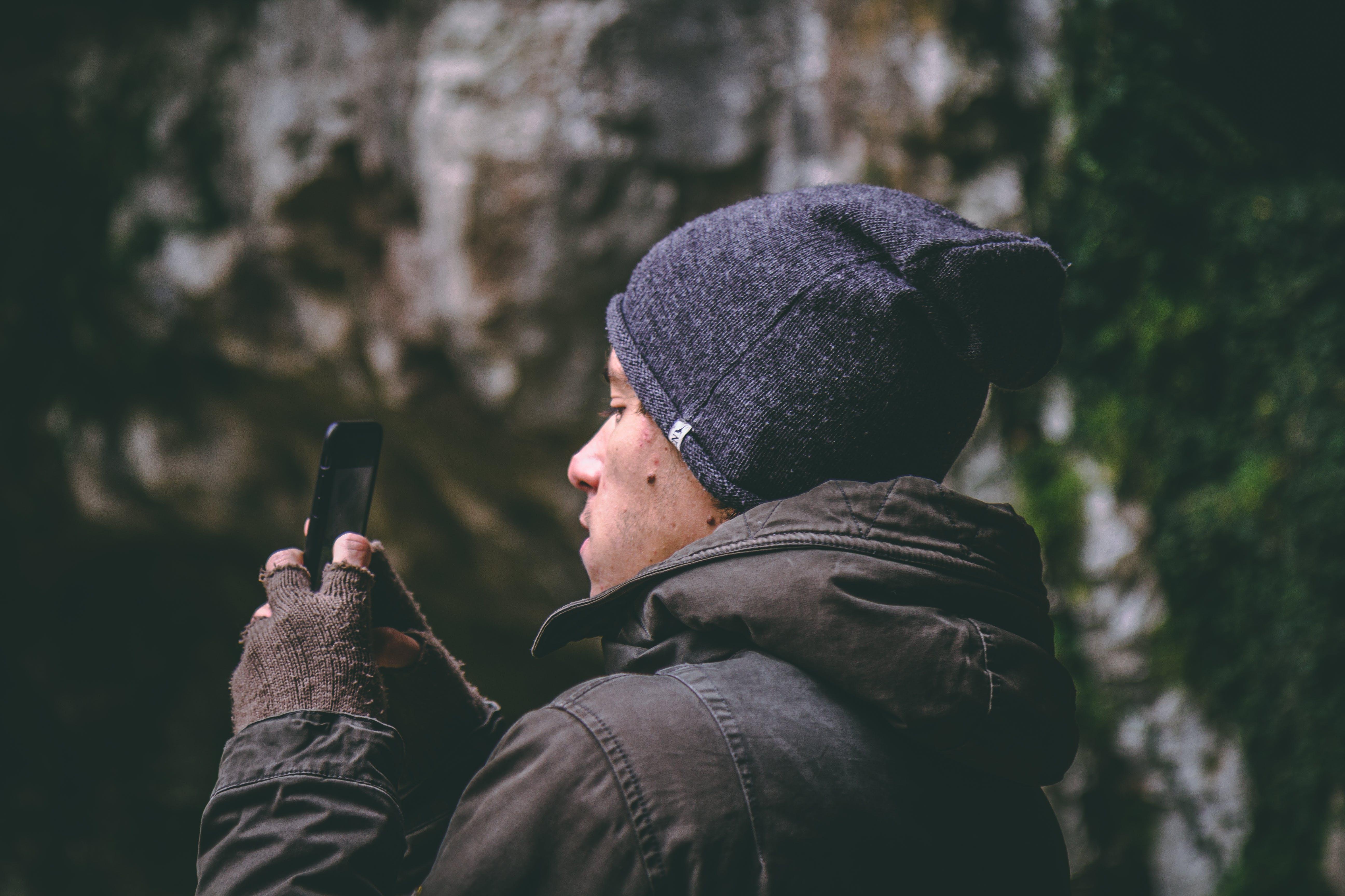 Man Wearing Beanie Holding Smartphone