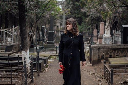 Woman in Black Coat Standing on Pathway