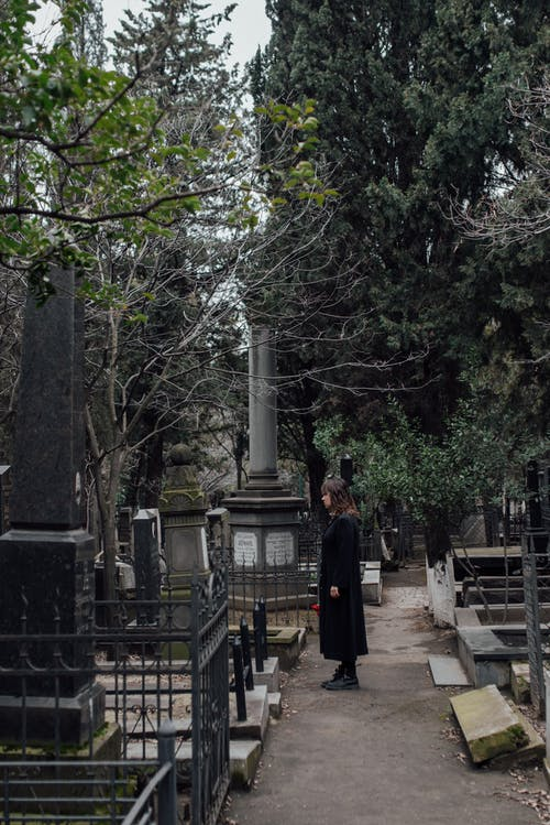 Woman Visiting A Loved One In Cemetery
