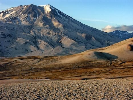 Photo of White Grey Mountain Beside Two Tone Brown Mountain during Daytime
