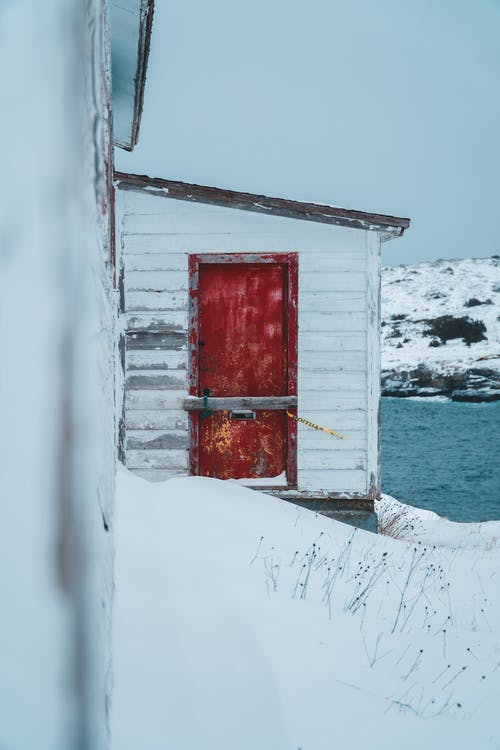 White Shed with a Red Door