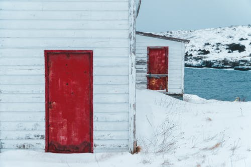 White Shed with Red Doors