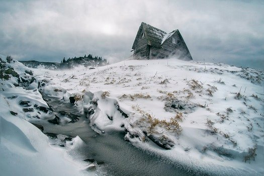 Gray House Surrounded by Snow