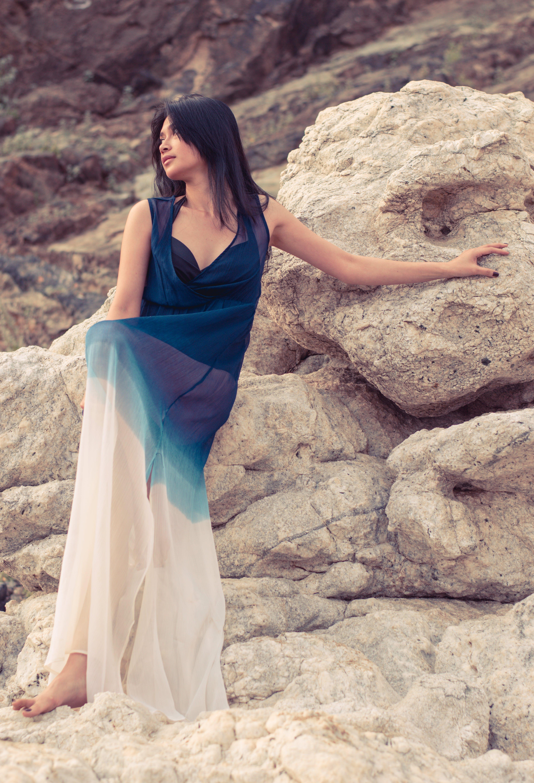 Woman Wearing Dress Standing on the Rock