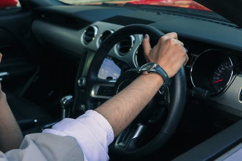 Person Holding a Steering Wheel