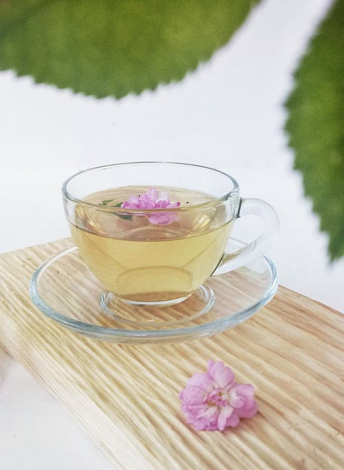 Close-Up Shot of a Cup of Herbal Tea on a Saucer