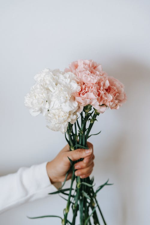 Anonymous person with bouquet of flowers