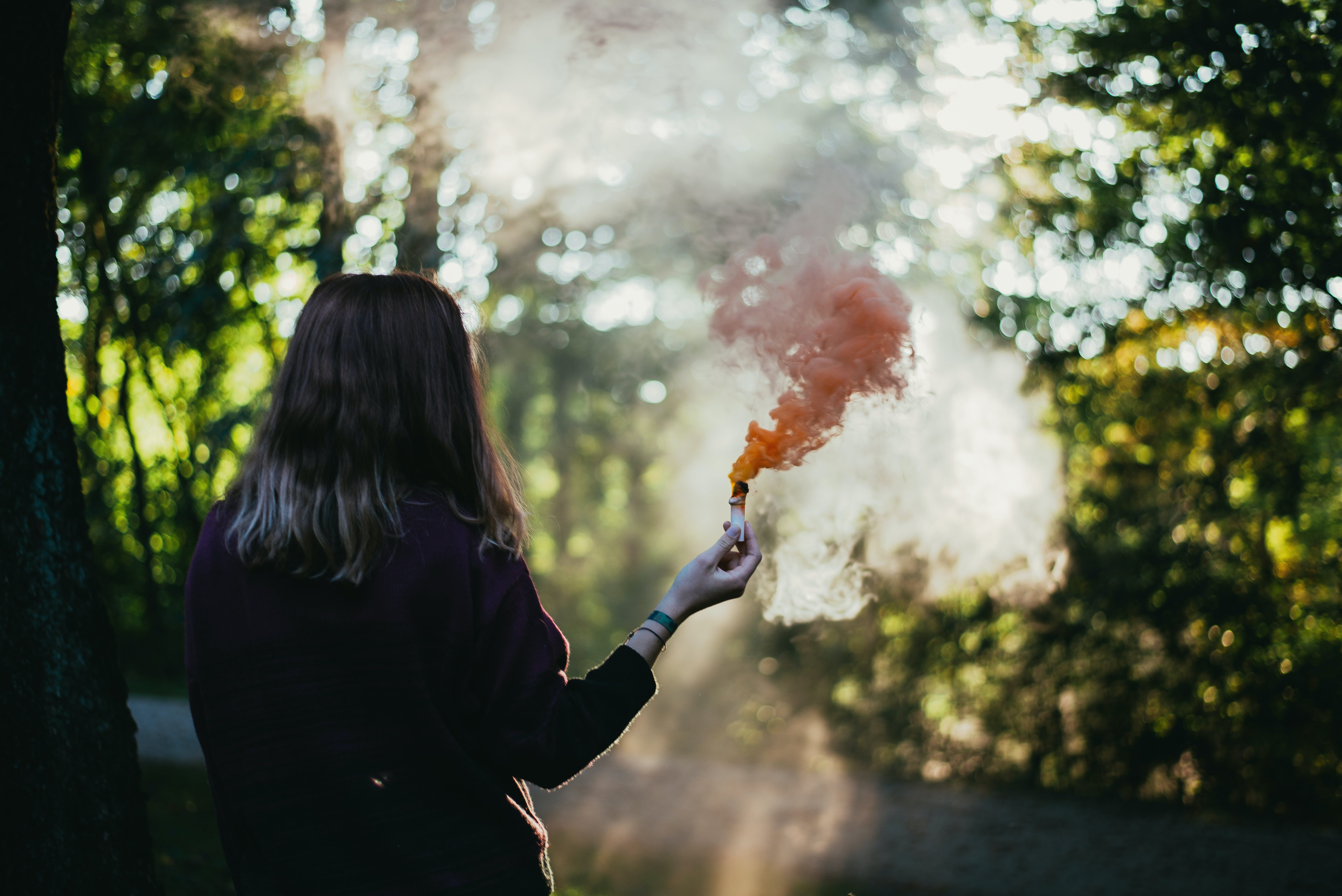 Woman Holding Red Flare
