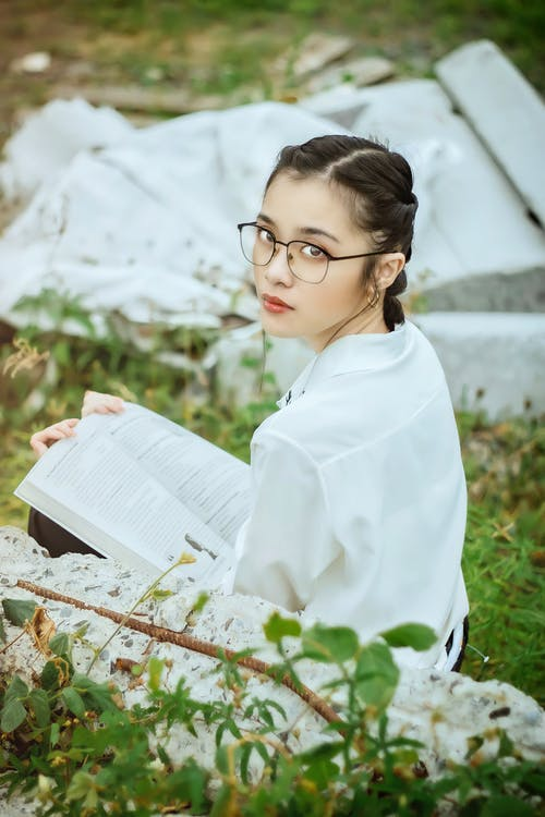 Woman in White Dress Shirt Reading Book