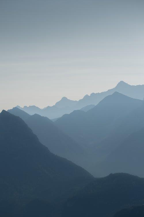 Mountains Under White Sky