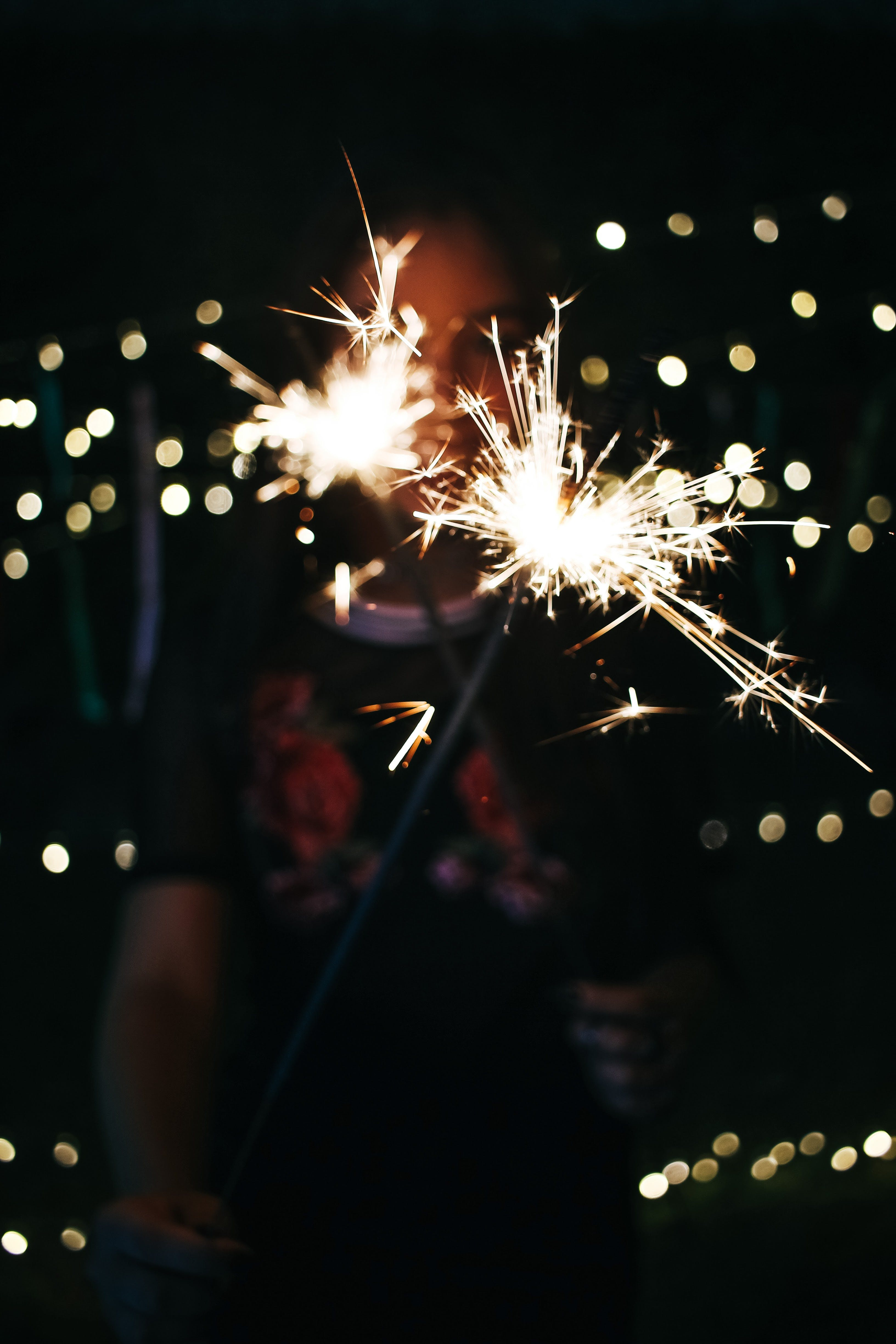 Bokeh Photography of Photo of Person Holding Sprinkler