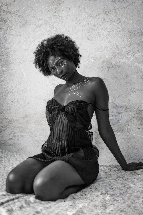 Woman in Black Tube Dress Sitting on Floor