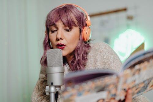 Woman in Cardigan Sweater Singing