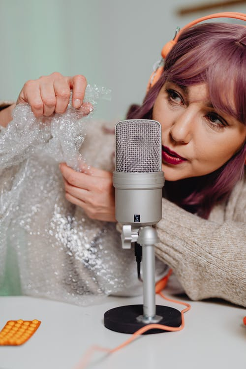 A Woman Pooping Bubble Wrap for Sound Effect
