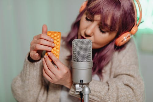 Woman Holding Microphone With Yellow Corn