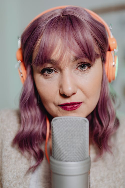 A Woman with a Headset and Microphone