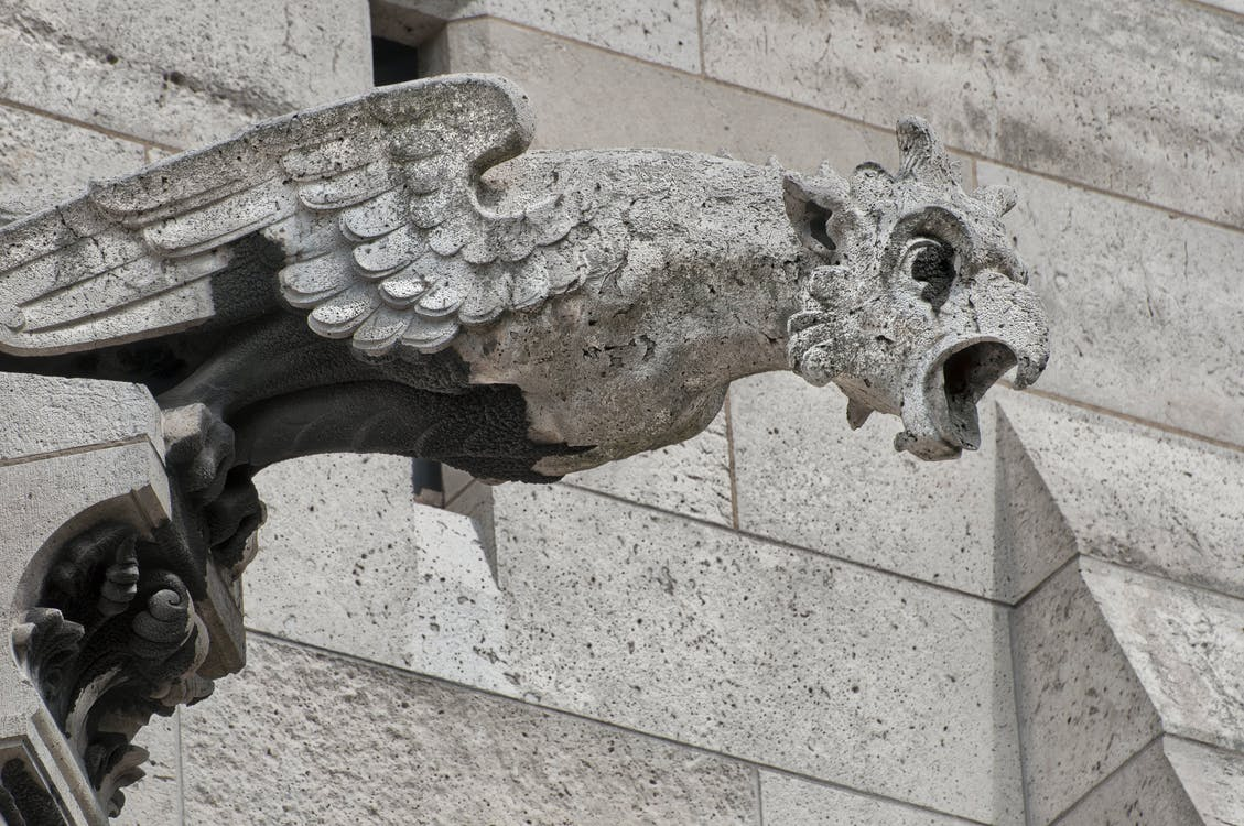 Grey Concrete Animal Statue on Grey Concrete Wall
