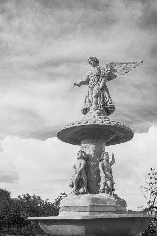 Angel Statue Under Cloudy Sky