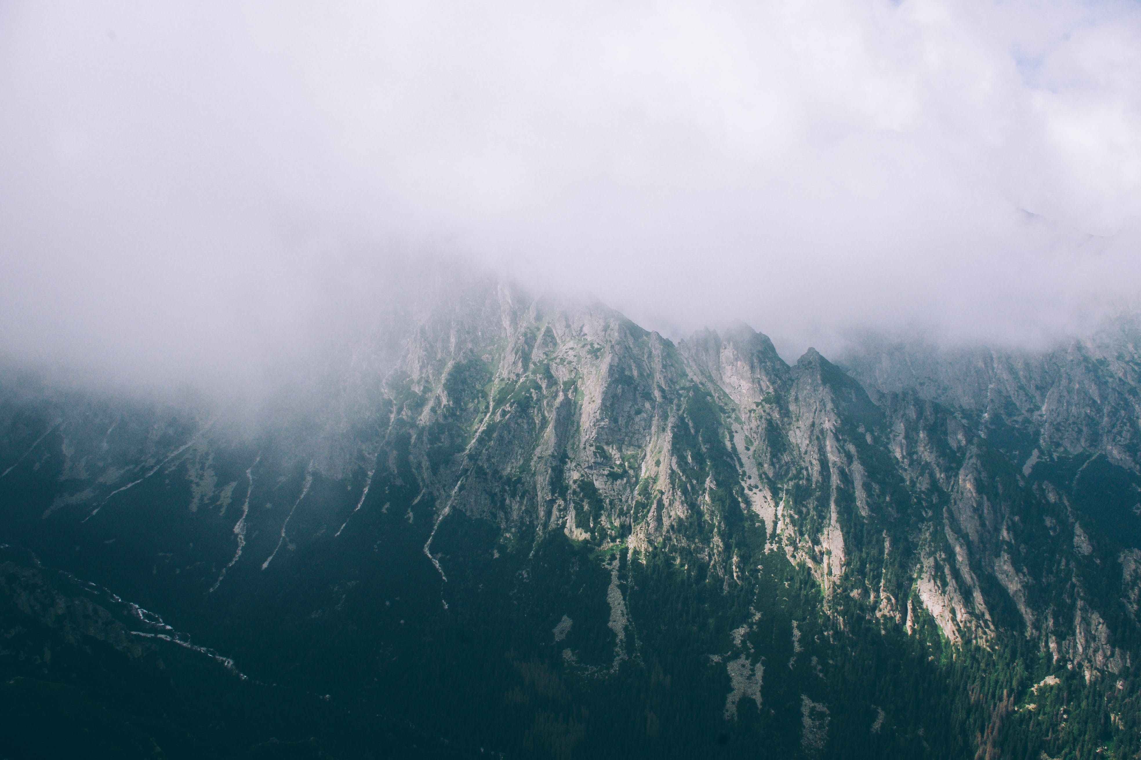 Bird's-eye View of Mountain Covered With Clouds