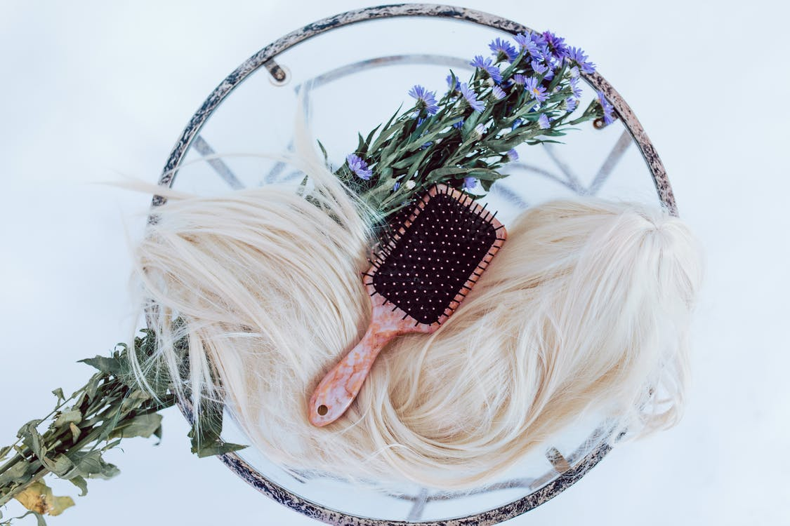 Black and White Hair Brush on White and Green Floral Wreath