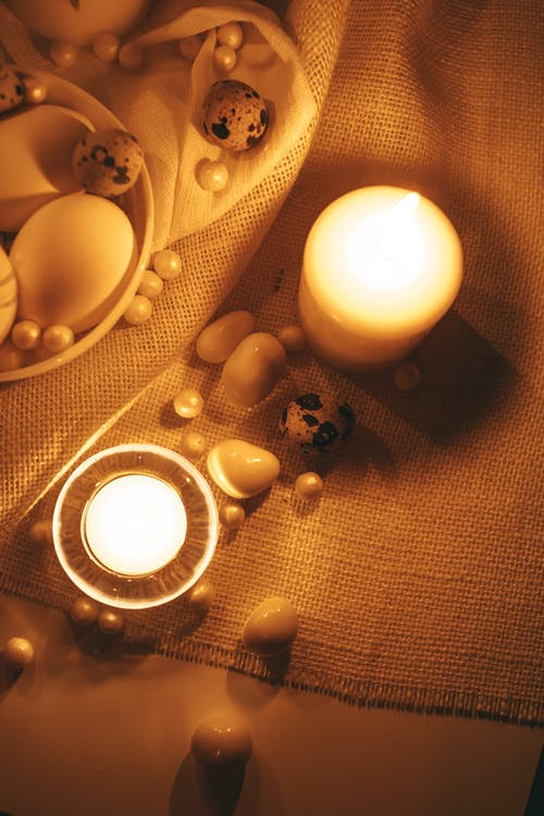White Lighted Candles With Gold Background