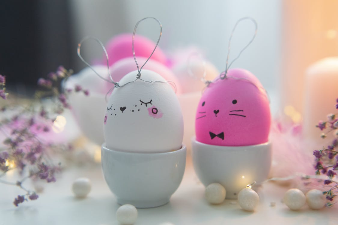 Pink and White Easter Bunny Eggs On Ceramic Cups
