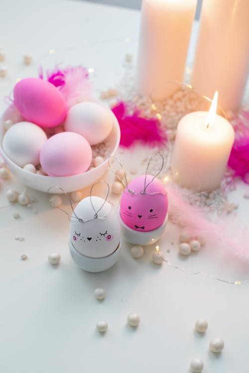Pink and White Candles on White Table
