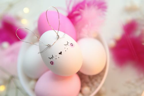 White and Pink Decorated Eggs On Bowl