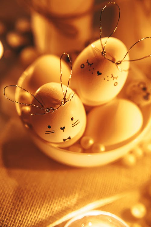 White Decorated Eggs In Golden Background