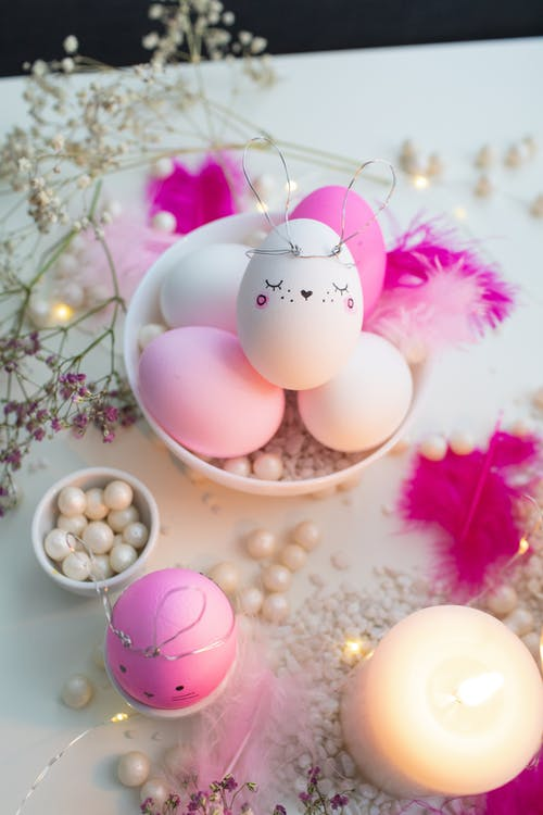 Pink and White Decorated Eggs on Table