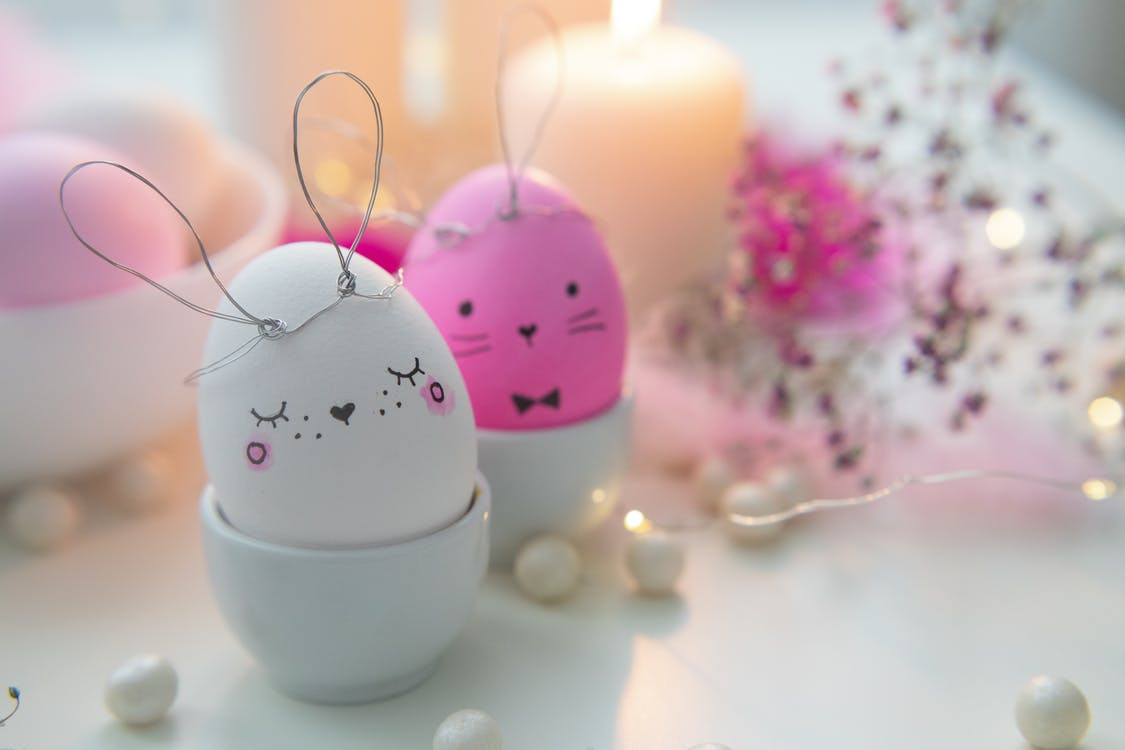 Pink Eggs and White Candles on White Table