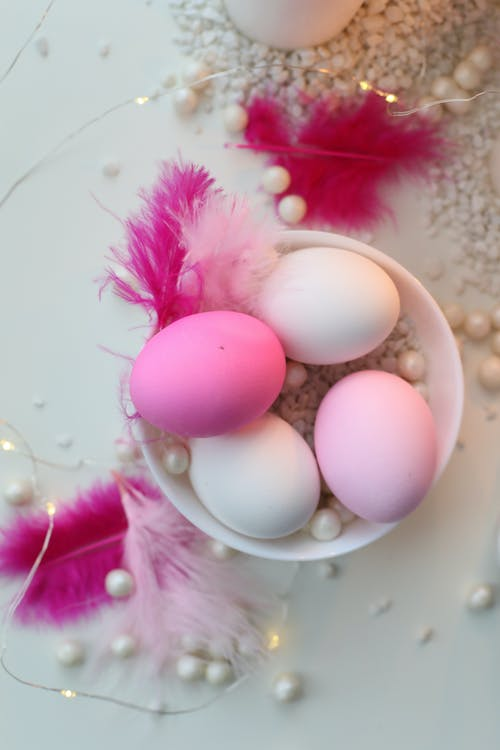 Pink Colored Eggs In A Bowl