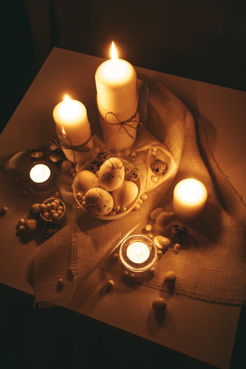 Lighted Candles on Table With Golden Background