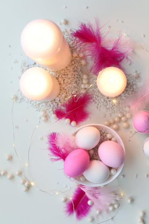 Top View Of Colored Eggs And Candles On Table