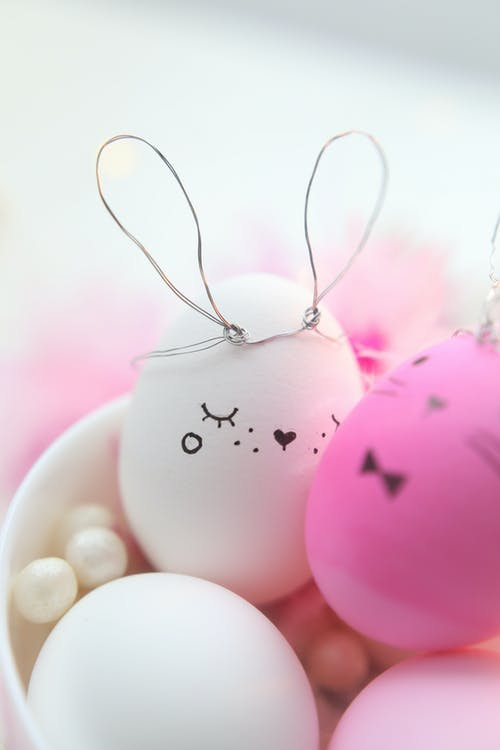 Pink and White Decorated Eggs In A Bowl