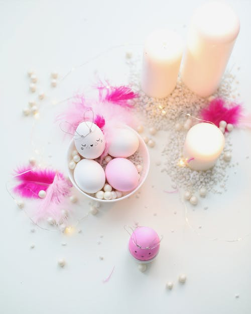 Easter Eggs And Candles On Table