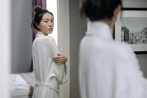 Man in White Thobe Standing Beside Woman in White Long Sleeve Dress