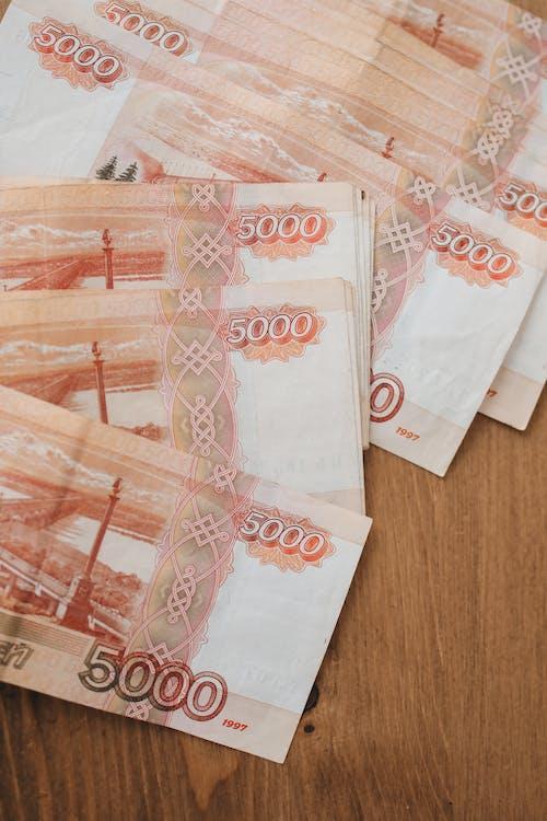 Foto profissional grátis de cédulas, contas, dinheiro